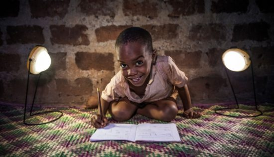 Child-Using-BrightLife-Lamps-for-Homework-as-a-Part-of-Contributing-to-the-SDGs-1071x612